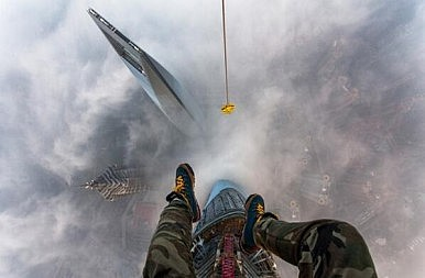 Don't Look Down! Russian Thrill Seekers Illegally Climb Shanghai Tower