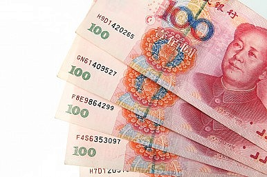 China Doubles Currency Trading Band