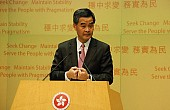 Hong Kong Chief Threatens to Sue Newspaper