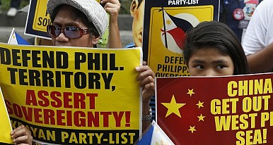 China Challenges ASEAN with Land Fills in South China Sea