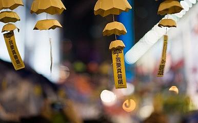 Hong Kong's Election Reform Plan Sparks Debate, Protests