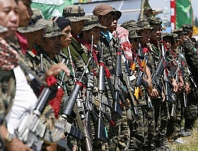 Philippine Muslim Rebels Begin Turning Over Weapons, Soldiers