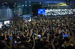 Hong Kong Postpones Political Development