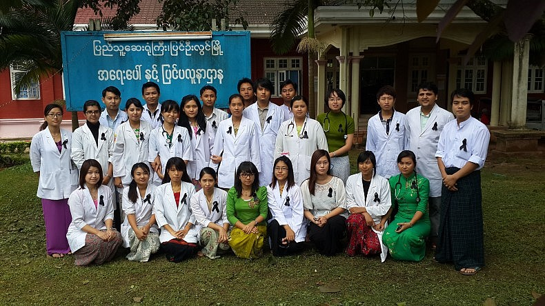 A group of assistant surgeons at the Pyin Oo Lwin 300 Bedded General Hospital show their unity with the Black Ribbon Movement.