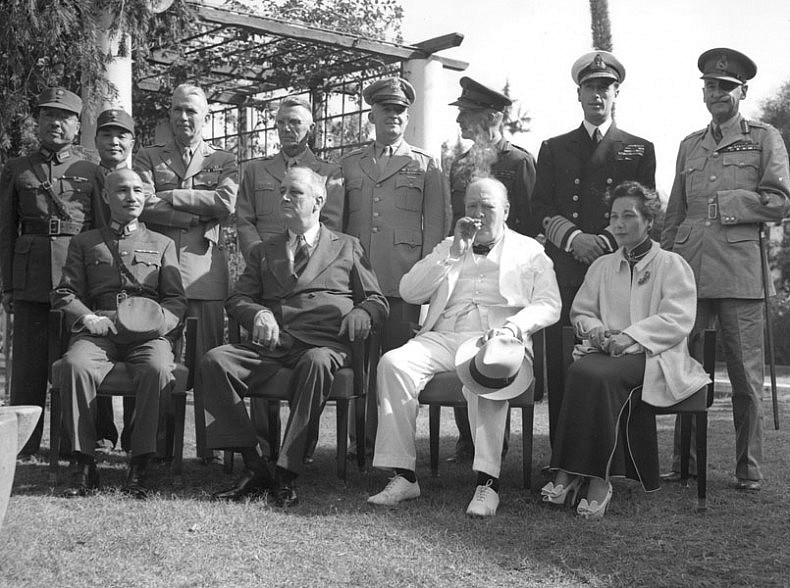 Chiang Kai-shek (seated, left) and Soong Mei-ling (seated, right) attend the Cairo Conference in 1943.