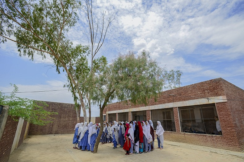 Young Afghan refugee girls at Asifi's school. Today, encouraged by Asifi's early example, 1,500 young people are enrolled in six schools throughout the refugee village. UNHCR/S. Rich