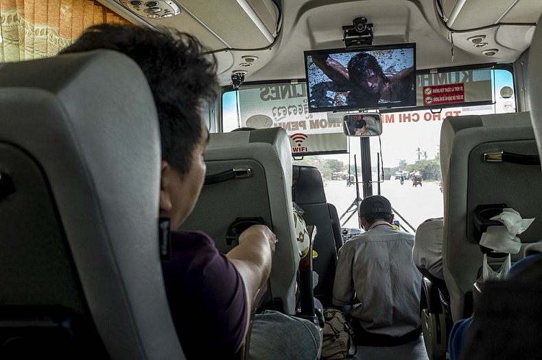 A scene from the Rambo as seen from the inside of the bus from Phnom Penh to Ho Chi Minh City as we start our first leg of the A River's Tail Journey in Vietnam.  Photo by Luc Forsyth.
