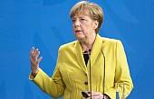 In China, Germany's Merkel Talks Trade, Syria, and South China Sea