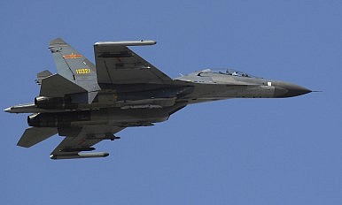 Chinese J-11 Fighters Exercise in the South China Sea After US Navy Patrols