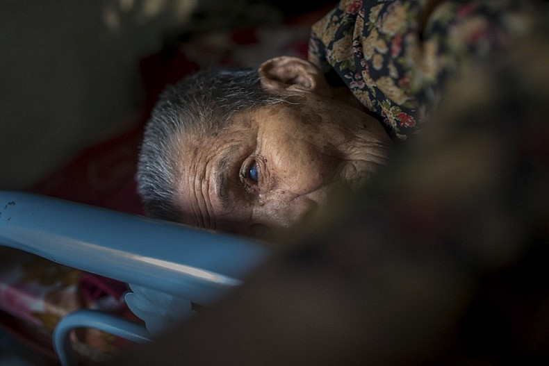 Ba, 84, lies in her family home. She's been blind for five years. Photo by Luc Forsyth.