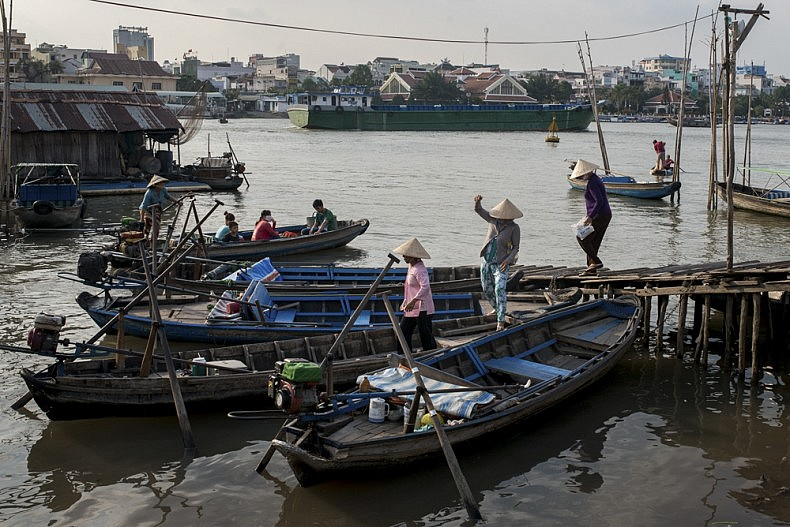 Passengers disembark from a water taxi in the city of Can Tho, the economic and commercial hub of the Mekong delta. Photo by Luc Forsyth.