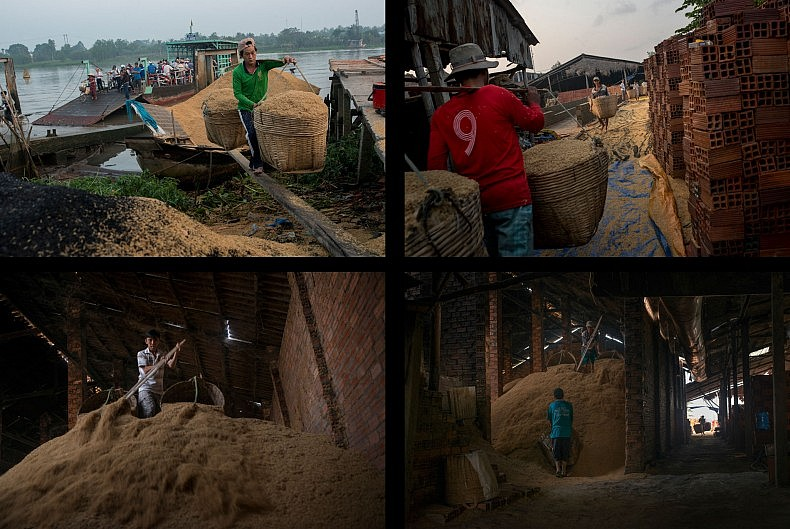 Workers unload rice husks from a boat on the river. Photos by Luc Forsyth.