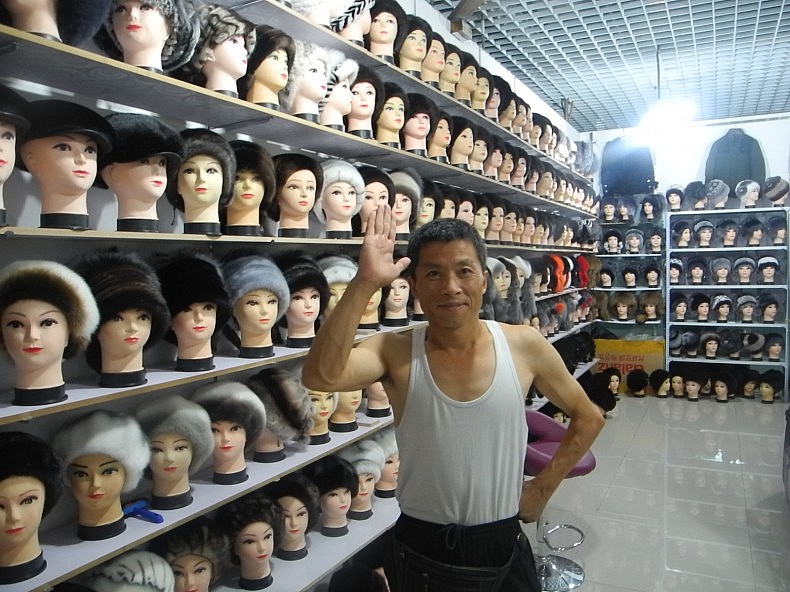 A Chinese merchant who sells fur wigs in the Horgos free trade zone. Photo by Wade Shepard.