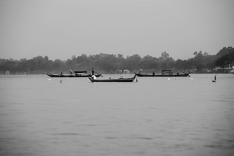 Early morning river traffic near the island of Long Binh. Photo by Gareth Bright.