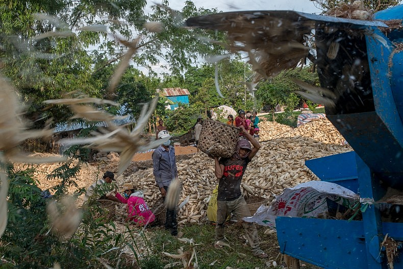 A machine separates the husks from ears of corn in the village of Khpob Ateav. Photo by Luc Forsyth,