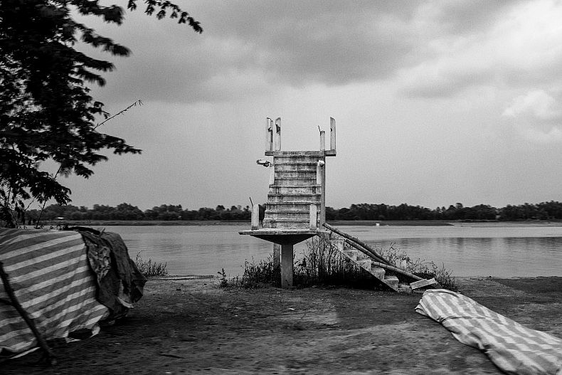 A staircase on the edge of the Mekong. The stairs are the only remains of a house whose owners were forced to relocate as river erosion washed away their land. Photo by Gareth Bright.