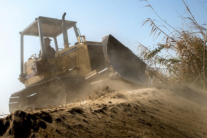 A bulldozer flattens sand that has filled in Phnom Penh's Boeung Kak Lake, once the largest freshwater lake in the city. Photo by Luc Forsyth.