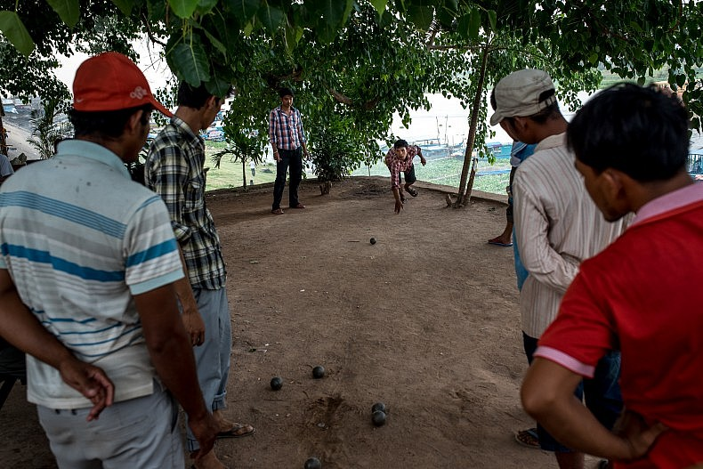 Locals in Kampong Chhnang play petanque, a French version of lawn bowling that was made popular in Cambodia during the French colonial period. Photo by Luc Forsyth.