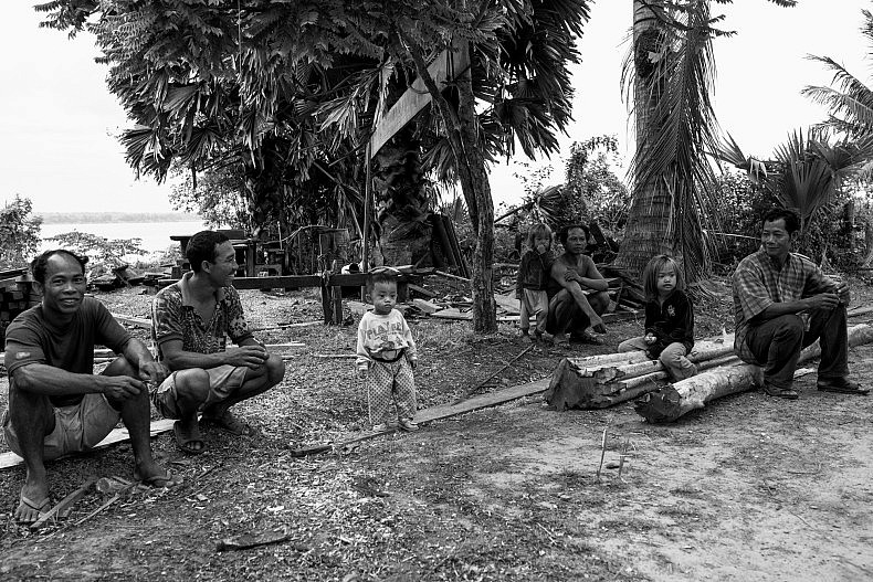 Residents of Koh Sralay. Families here are entirely reliant on the river for survial and will be heavily impacted by the Chinese-owned Sesan II dam, which will disrupt fish migrations and sediment flow. Photo by Gareth Bright.