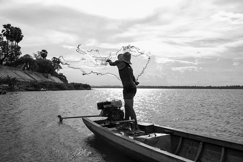 A fisherman flings out his net. Photo by Gareth Bright.