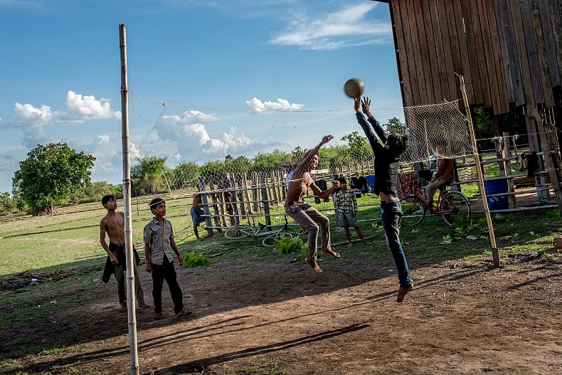Young Bunong men play volleyball in the afternoon in the village of Kbal Romeas, northeastern Cambodia. Photo by Luc Forsyth.