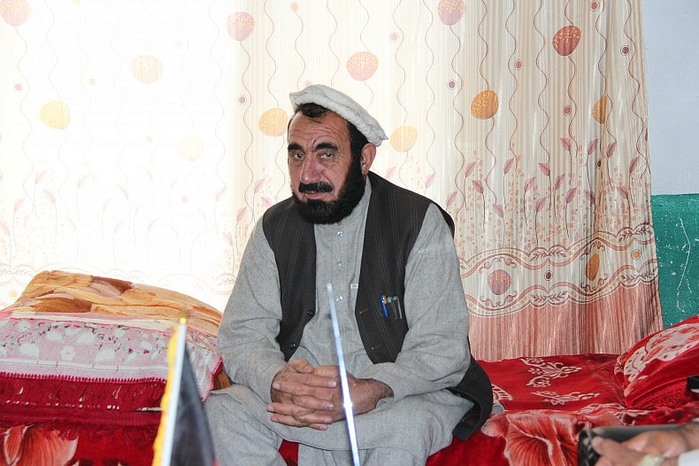 Achin District Governor Haji Ghalib Mujahid in his office. Photo by Silab Mangal.