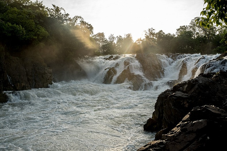 An elevated section of the Khone Phapheng waterfalls (Khone Falls). The Khone Falls stretch the breadth of the Mekong river and prevent it from acting as a commercially viable transportation route. Photo by Luc Forsyth.