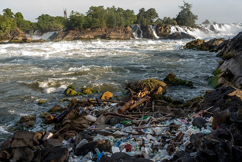 Plastic bottles and other waste from the upstream tourist destination of Si Phan Don (4000 islands) collects below the Khone Phapheng waterfalls. Photo by Luc Forsyth.