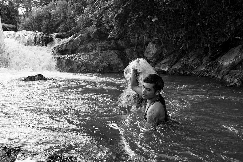 A man wishes in the pools above the Khone Phapheng waterfalls. Photo by Gareth Bright.