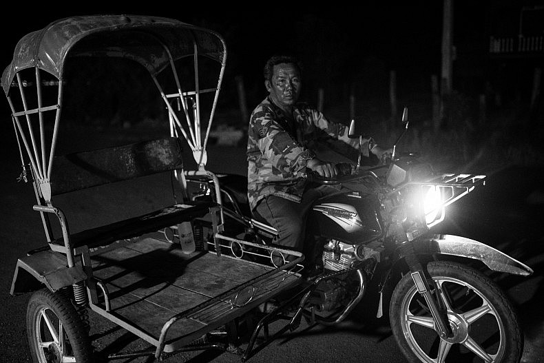 One way to travel is by motorbike taxi. Photo by Gareth Bright.