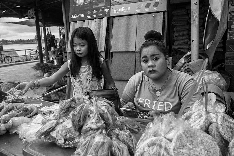 Merchants in the market estimate that they are getting half the fish out of the Mekong that they got a decade ago. Photo by Gareth Bright.