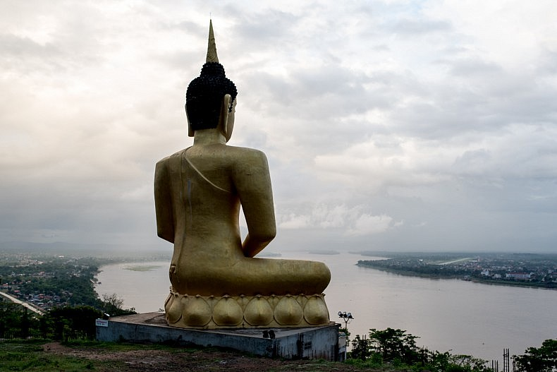A statue of Buddha sits overlooking the Mekong river in the city of Pakse. Photo by Luc Forsyth.