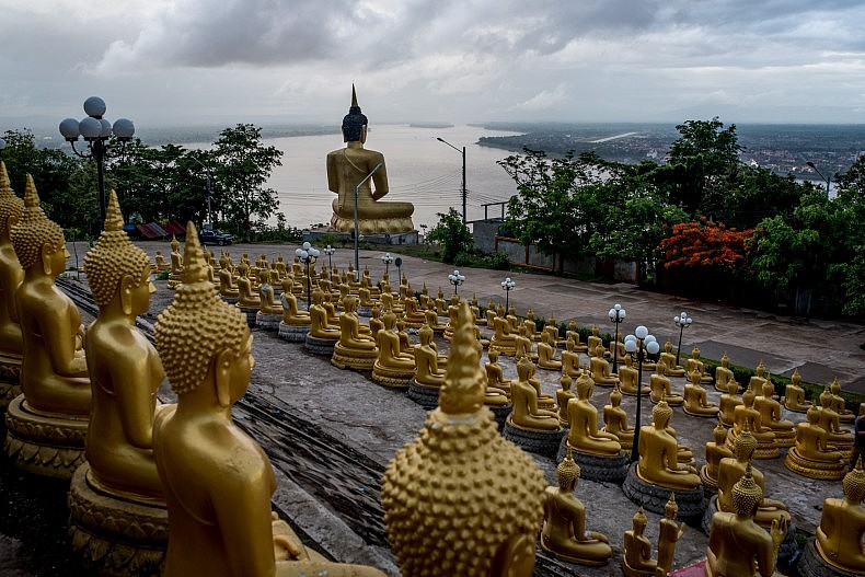 Hundreds of privately donated statues sit in front of the Phon Salao pagoda in Pakse.  Photo by Luc Forsyth.