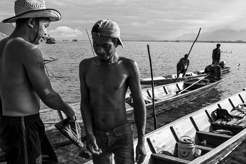 Fishermen on the Nam Ngum dam's reservoir. Photo by Gareth Bright.