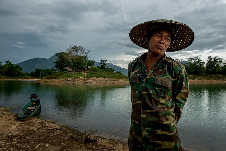 Si Phan, 62, is a fisherman who lives part time on an island in the middle of the Nam Ngum dam's reservoir. Photo by Luc Forsyth.