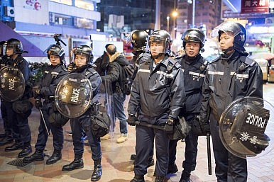 All Eyes on China's Enforcer in Hong Kong