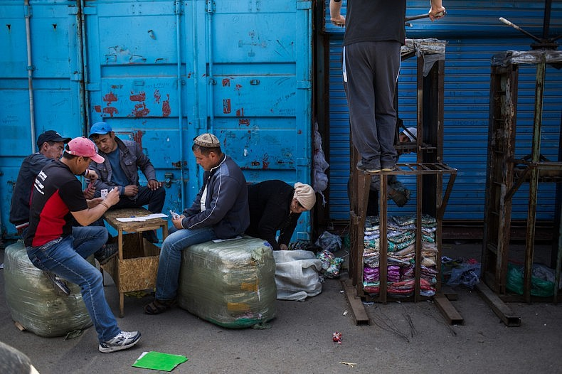 Packaging workers playing cards. There is no work, they say.  Source: Elyor Nematov