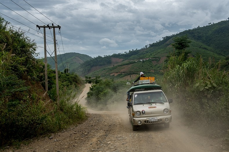 A passenger vehicle drives along the access road that links the Nam Kong 1 and Nam Kong 2 dam construction sites. When completed, the dams will inundate more than 1500km of land under their reservoirs.