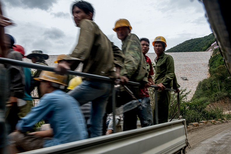 Chinese construction workers drive through the site of the Nam Kong 2 dam. Photo by Luc Forsyth.