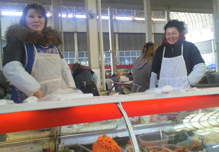 Local Korean sellers at a typical Korean salad stand in Tashkent. Courtesy of Victoria Kim.