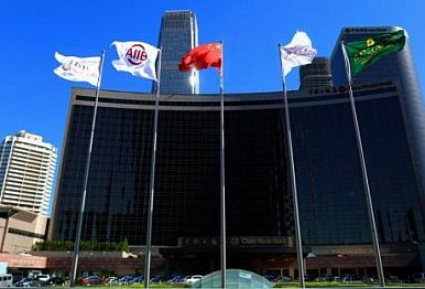 At First Annual Meeting, China-led AIIB Approves First Loans