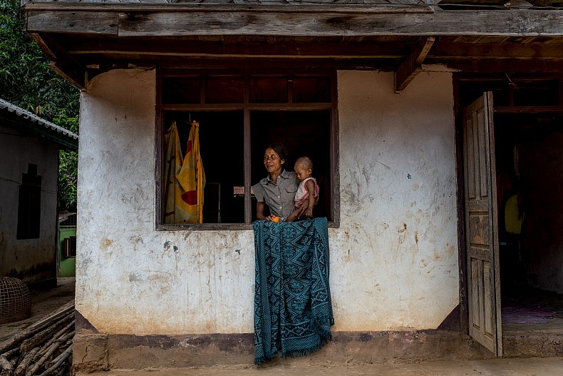 A woman and her baby in the village of Khoc Kham. Photo by Luc Forsyth.