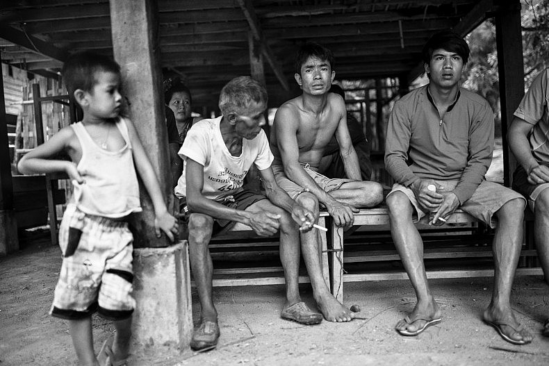 Group of men living in the village of Khoc Kham. Photo by Gareth Bright.