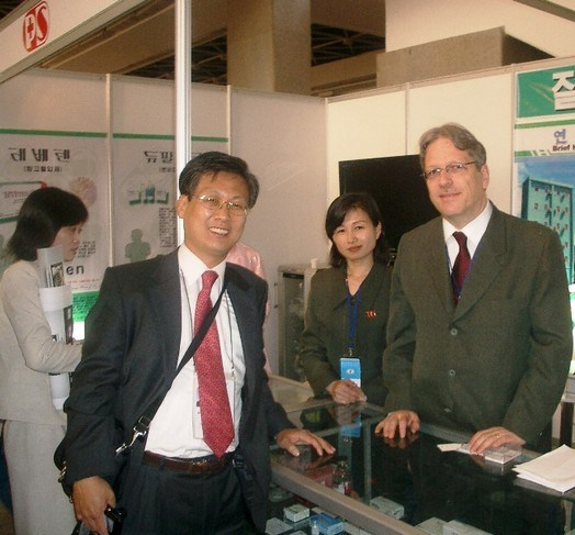 """When """"Sunshine"""" made it possible: South Korean lawmakers visiting a trade fair in Pyongyang, meeting up with Felix Abt and his North Korean staff at their booth. Image courtesy of Felix Abt."""