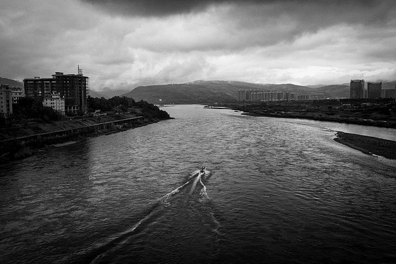 A tourist boat makes its way along the Lancang (Mekong) river in Xishuangbanna, Yunan, China. Photo by Gareth Bright.