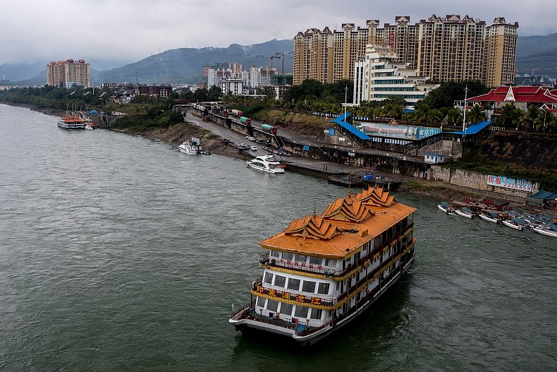 A floating restaurant and leisure ship floats down the Lancang (Mekong) in Xishuangbanna, Yunnan, China. Photo by Luc Forsyth.