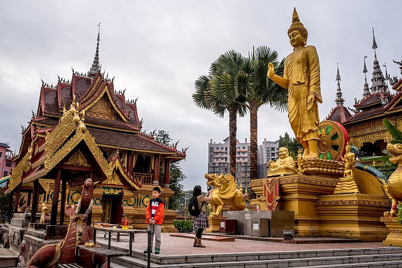Xishuangbanna, China--with sites like this large Buddhist temple--is a popular desitnation for Chinese vacationers, but there were few foreign tourists. Photo by Luc Forsyth.