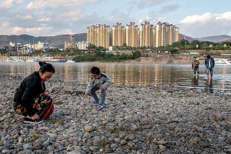 Whether it is called the Lancang or the Mekong, the river brings people to its banks. Photo by Luc Forsyth.