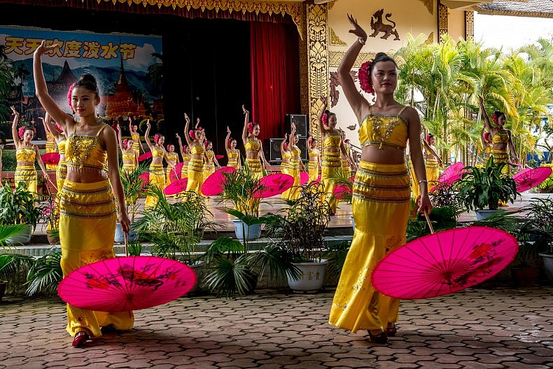 Dancers perform for tourists at the Olive Dam Dai cultural village in Xishuangbanna, China. Photo by Luc Forsyth.