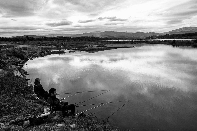 Residents fish in the Lancang (Mekong) river near Manhenuan village. Photo by Gareth Bright.